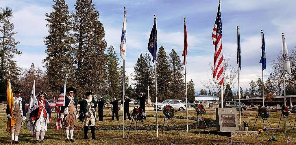Wreaths Across America Day, an event during which supporters place beautiful, patriotic-themed wreaths on graves of fallen heroes, is scheduled for Dec. 19 and will have COVID restrictions. This photo is from last year's event, which was open to the public.
