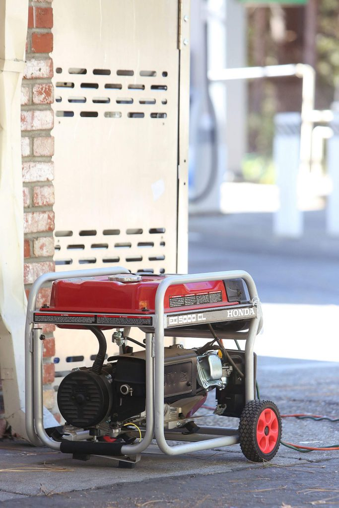 A small gas powered generator is used by the Chevron in Nevada City Tuesday during the the most recent PG&E Public Safety Power Shut-off.