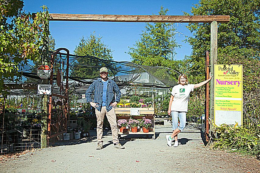 Bill Hageman, left, is the new owner of Peaceful Valley Farm & Garden Supply. He and his wife bought the business from Patricia Boudier, right.