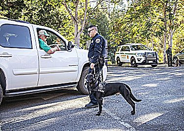 K9 Kano and Officer Evan Butler of the Grass Valley Police Department greeting a guest.