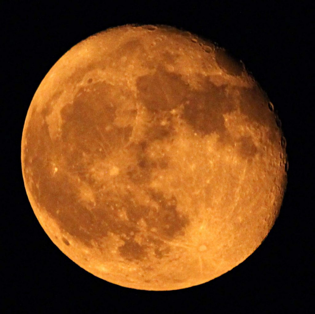 The moon was orange on Saturday night. On Sunday night, it was back to being white again.