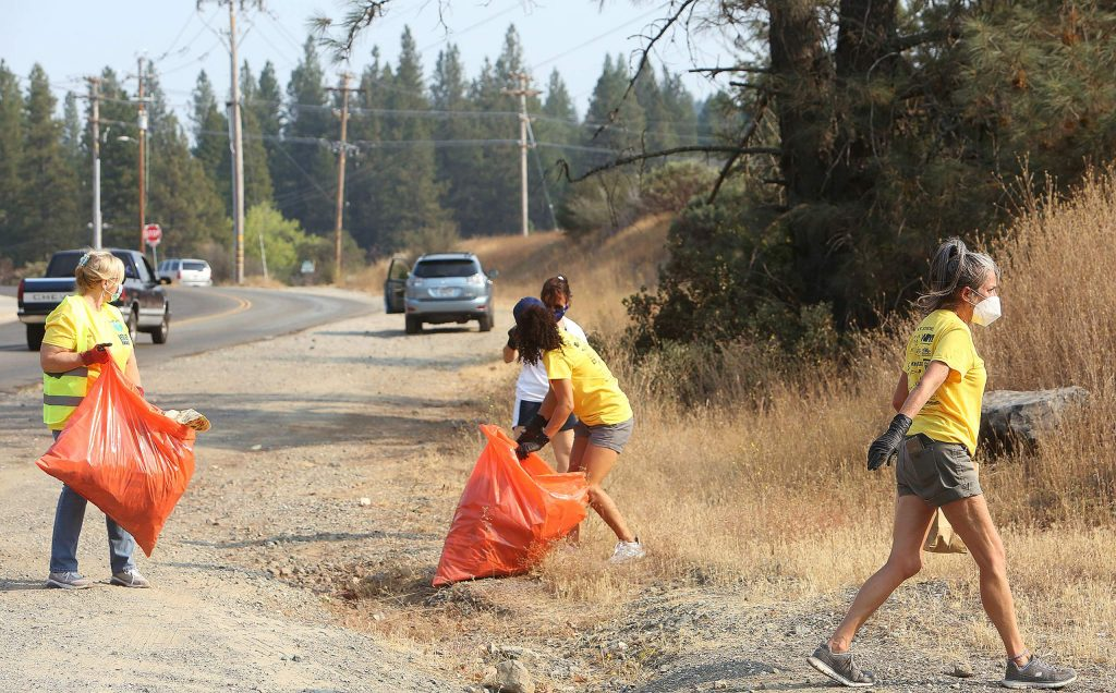 Volunteers pick up trash along Sutton Way during Saturday's RAKE event.