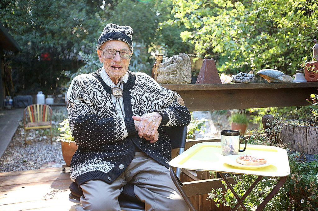 """Arthur """"Rudy"""" Thompson smiles from the back porch of his Alta Sierra home where he's lived since the late 1970s. Thompson turned 108 Wednesday and has lived a life that included hitchhiking on boats, operating his own small salmon fishery, and train hopping before spending five years in the Navy."""