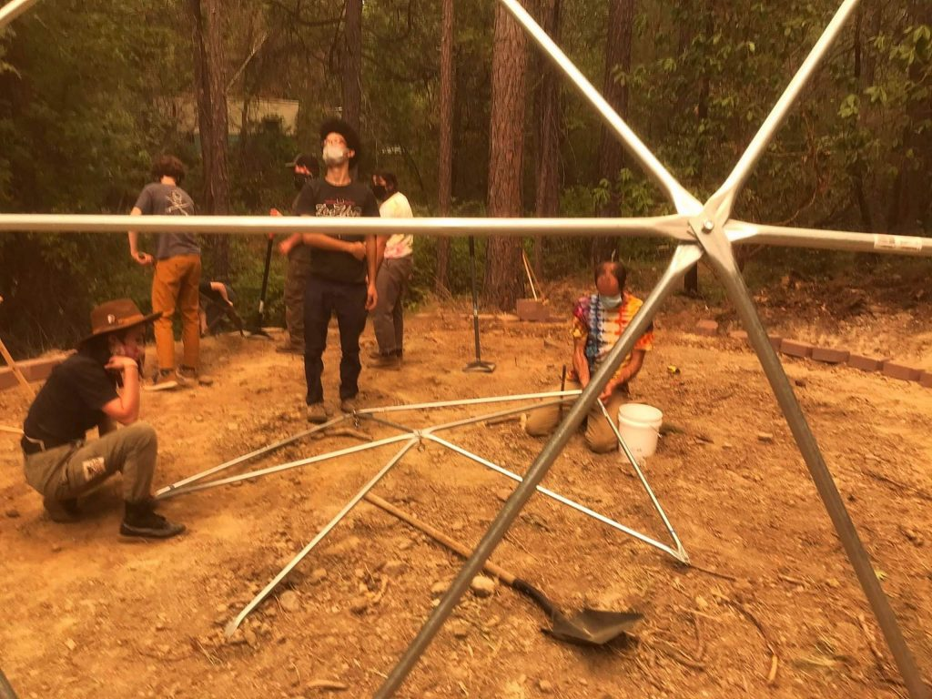 Sol Learning Institute students construct a geodesic dome greenhouse.