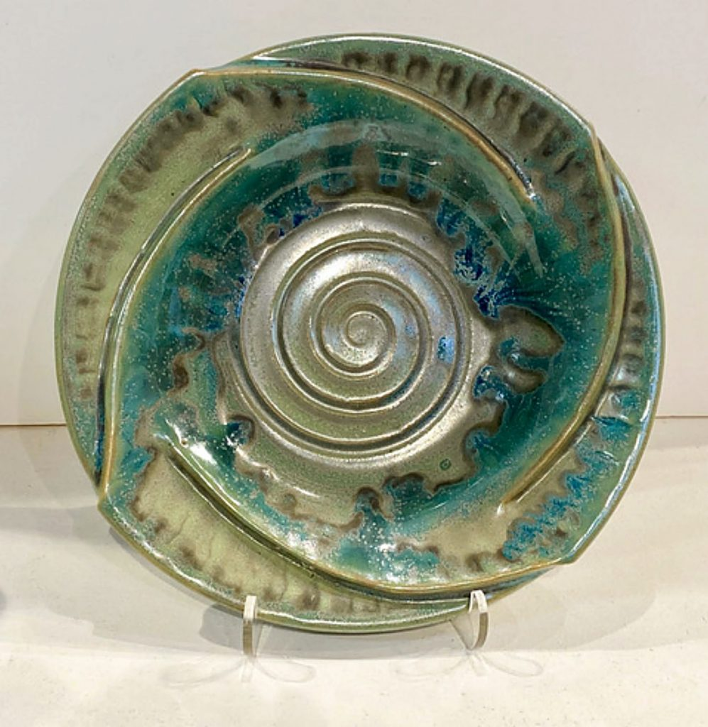 A Fibonacci rim plate by local artist Mindy Oberne. Oberne's studio will be available to tour during Open Studios 2020.
