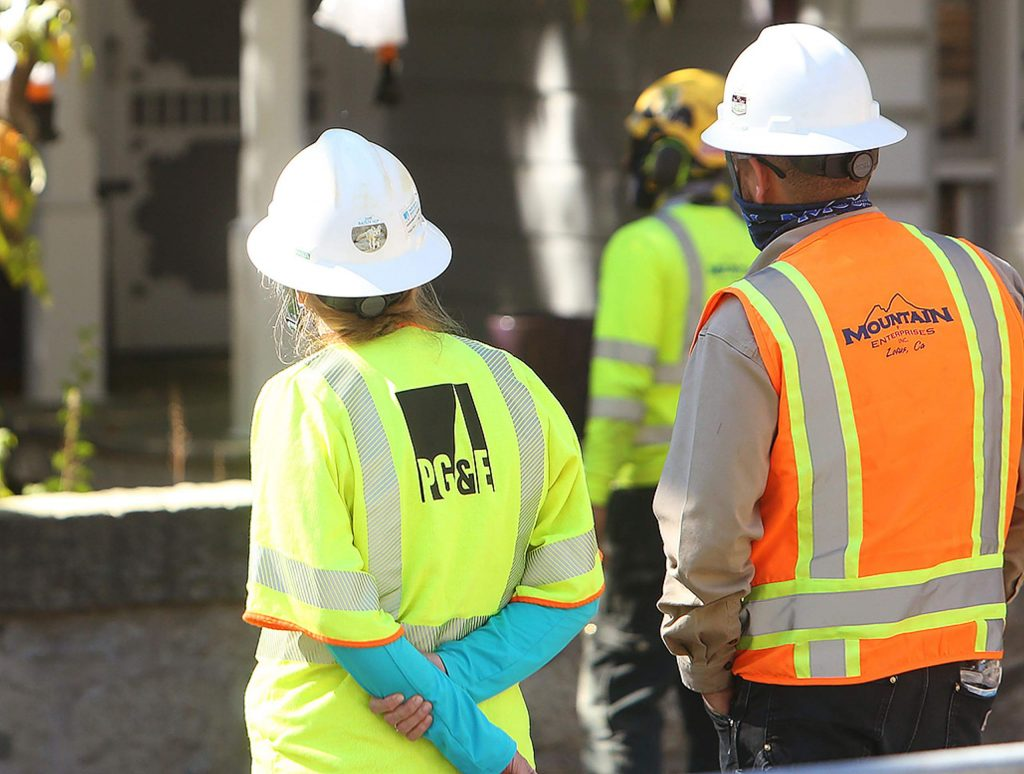 PG&E representatives were on hand to supervise the cutting of the blue Atlas cedar, which was recently at the center of protests against PG&E's decision to cut over 200 trees in Nevada City.
