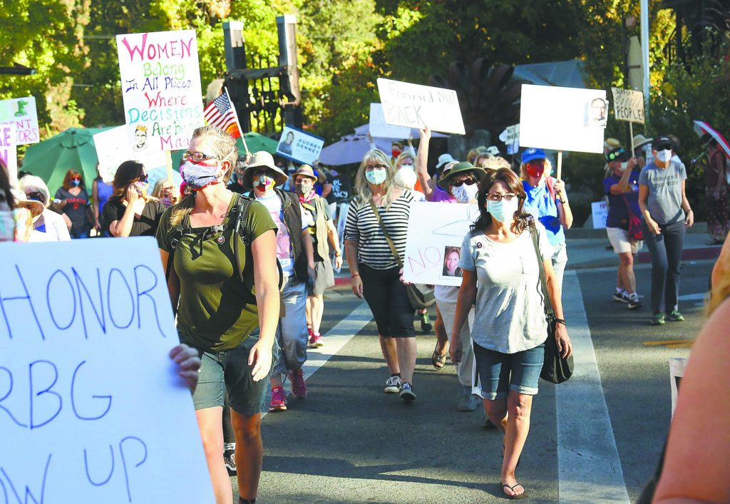 A group of about 100 women took part in Nevada City's contribution to the nationwide women's marches that took place Saturday.