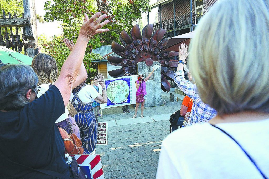 Organizers ask how many of the group had already voted. About half the people raised their hands prior to Saturday's women's march in Nevada City.