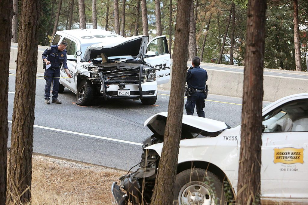 The front end of a Grass Valley Police Department cruiser sits smashed in the southbound Highway 49 lanes near McKnight Way Thursday afternoon, after a wrong-way stolen Hansen Bros. vehicle collided with it, authorities said.