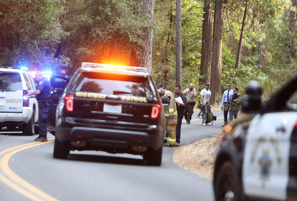 California Highway Patrol, Grass Valley Police Department, and Nevada County Sheriff's officers convene along Allison Ranch Road after apprehending the suspect in the Wolf Creek drainage Thursday afternoon.