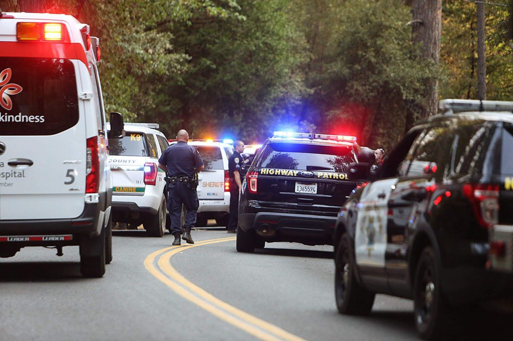 Officers convene on Allison Ranch Road Thursday afternoon to apprehend 37-year-old Patrick Grady, of Sacramento, who authorities say stole a Hansen Bros. vehicle and hit a police officer head-on on Highway 49.