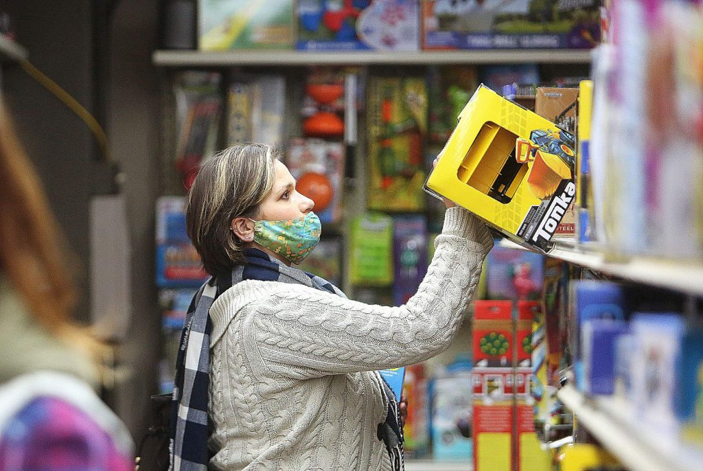 Katie Ambros gets some early holiday shopping done Wednesday at Foothill Mercantile in downtown Grass Valley, where the store's second floor has a large supply of classic children's toys for sale.