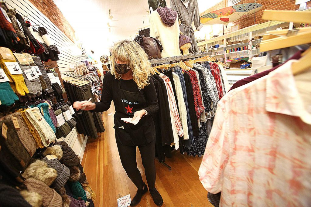 Stephanie Bamsch helps organize items for sale at Yuba Blue earlier this week in anticipation of Black Friday shopping in downtown Grass Valley.