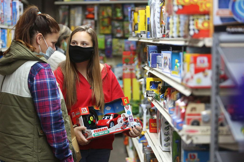 Grace and Jennifer Przybycki help get some early holiday shopping done this week at Foothill Mercantile in downtown Grass Valley.