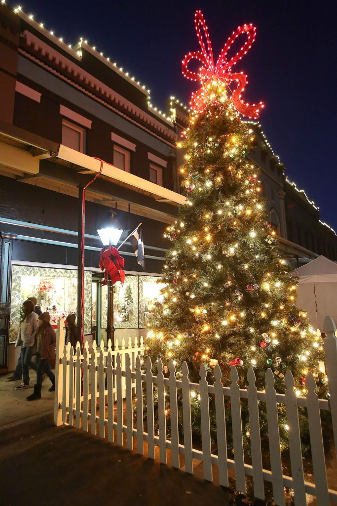 A festively decorated Christmas tree can be found in downtown Grass Valley along Mill Street, where many vendors have set up outdoor accommodations.