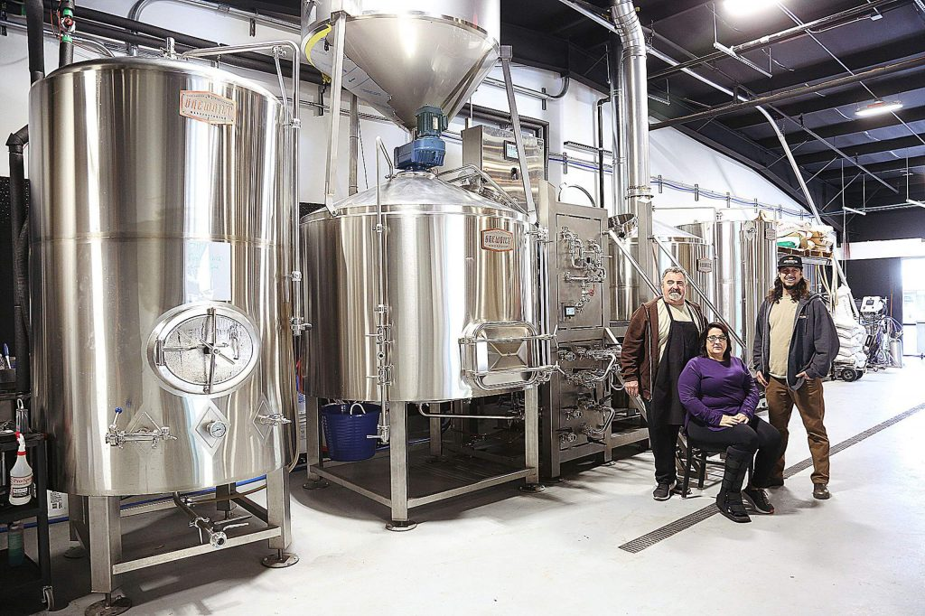 Dave Nelson, Tina Harland and Scott Helmus sit in the brewing area of their new business venture, Bullmastiff Brewing based in Penn Valley. Nelson and Harland are co-owners while Helmus is the brewmaster.