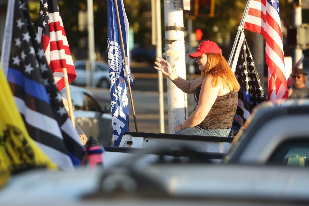 About a dozen Trump supporters gathered along the corner of Neal and South Auburn streets Wednesday afternoon during a Trump 2020 post-election rally for America.