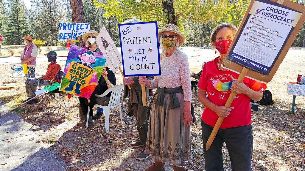 Democracy defenders gather along Maidu Avenue in Nevada City Wednesday to defend the integrity of the election and make sure that every vote is counted.