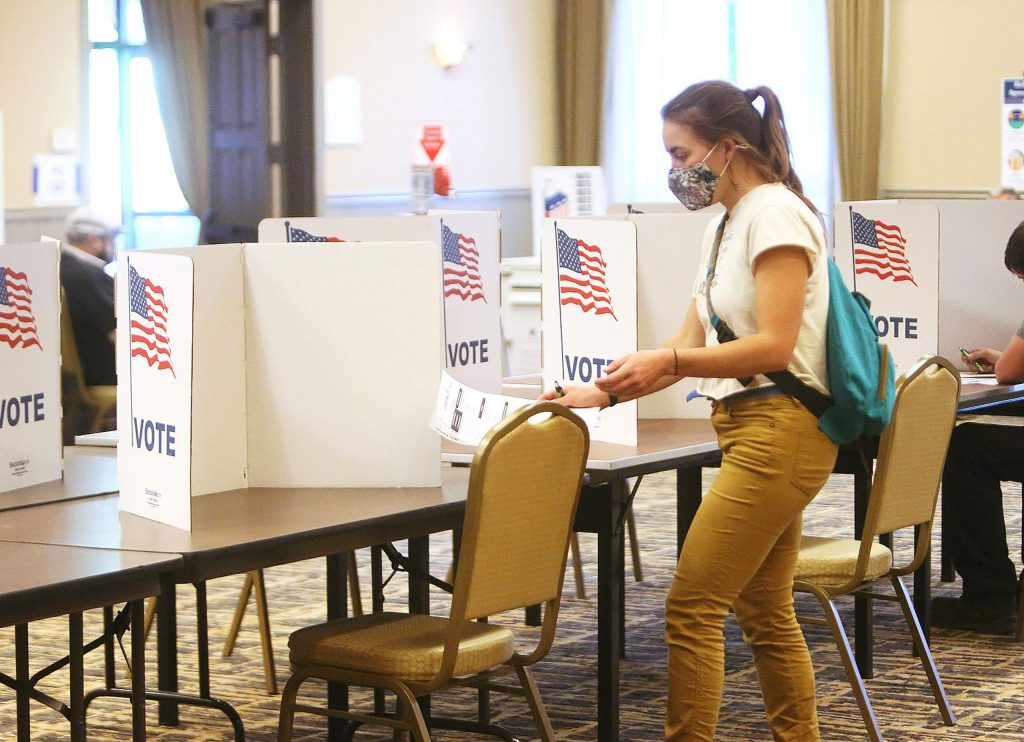 A young voter readies to cast her ballot Saturday at the Gold Miners Inn in Grass Valley, one of several Nevada County voting centers.