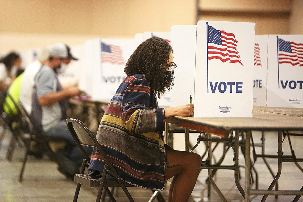 Taylor Wilson, a first-time voter and Grass Valley resident, fills out her ballot in person at the Nevada County Fairgrounds' vote center Tuesday afternoon, as did many others.