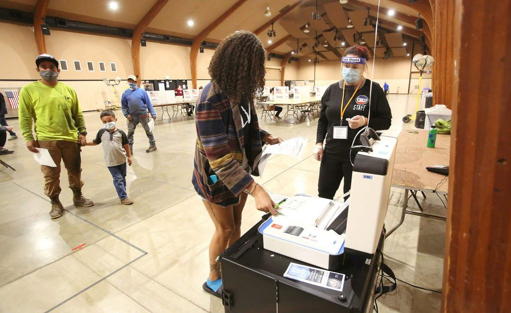 First-time voter Taylor Wilson casts her ballot Tuesday at the Nevada County Fairgrounds' vote center in Grass Valley.