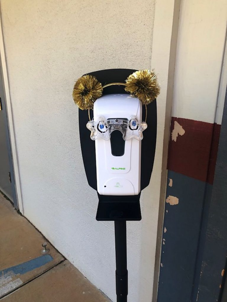 A friendly hand sanitizer station greets students as they return back to campus as part of the Grass Valley School District's new hybrid model.