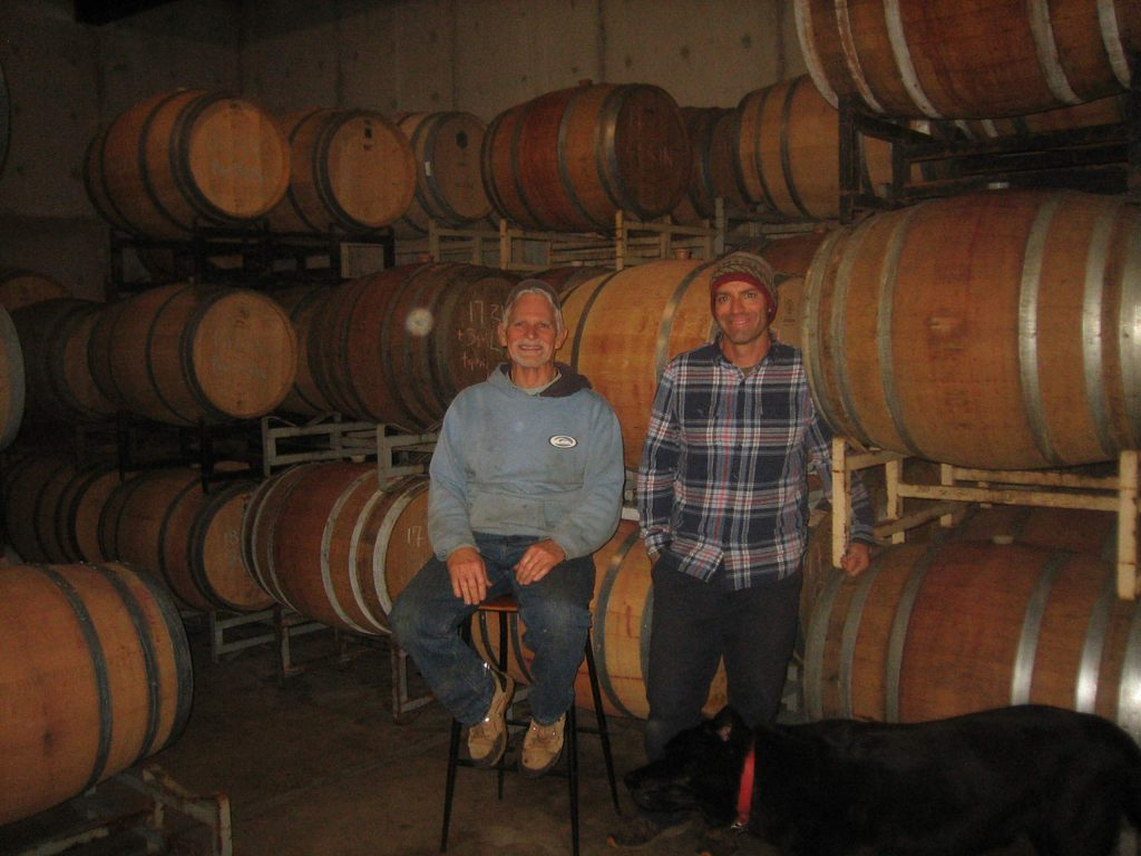Phil and Jackson Starr of Sierra Starr Vineyard & Winery standing in the barrel room at their Grass Valley winery.