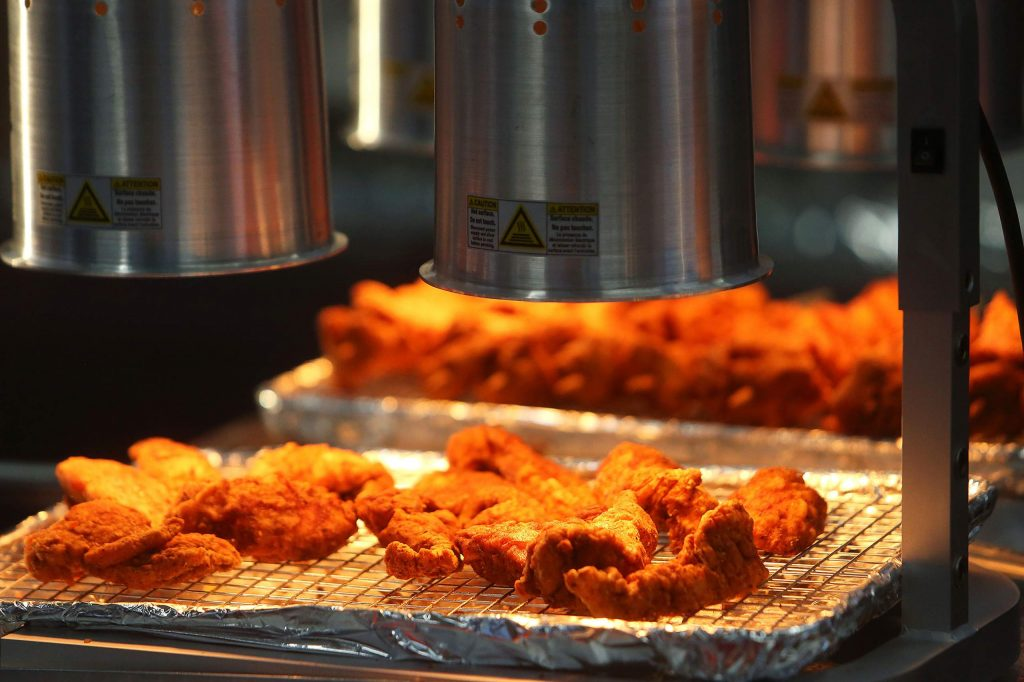 Fried chicken from Boguey's Chicken and Waffle's sits ready to go Friday at the Nevada County Fairgrounds.