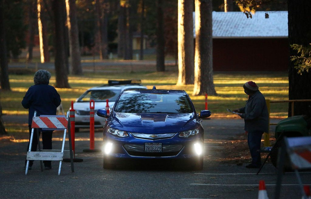 Vehicles drive onto the Nevada County Fairgrounds to pick up their barbecue pulled pork meals and a pie during Tuesday's Thankful for the Fairgrounds Fundraiser.