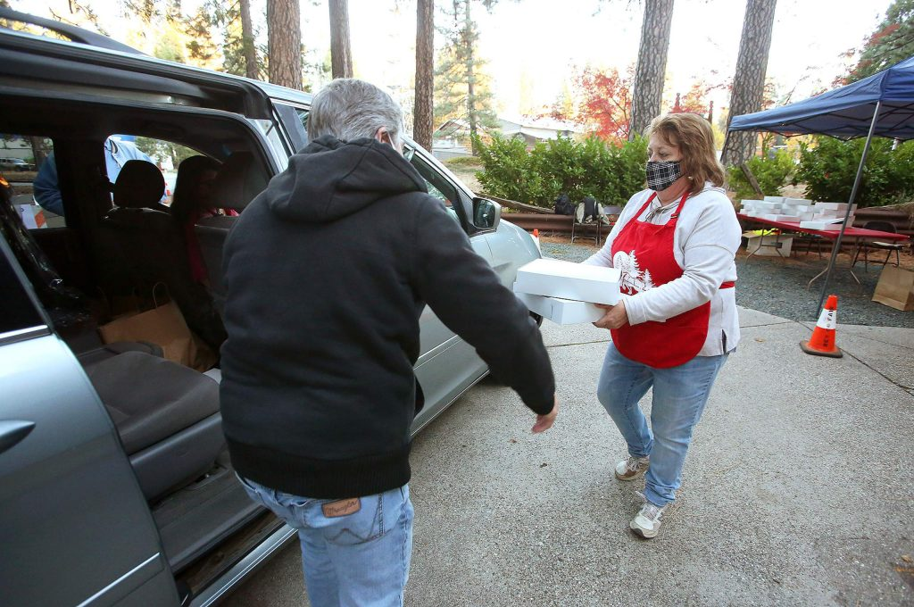 Barbara and Larry McDonald load a pair of pumpkin pies into a van during the drive-thru Thankful for the Fairgrounds Fundraiser, which included a barbecue meal for four. Proceeds from the event go toward supporting the fairgrounds.