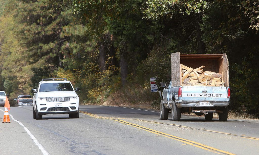 A truck packed with cut firewood is headed to the home of a senior to help provide warmth during the cold winter months.
