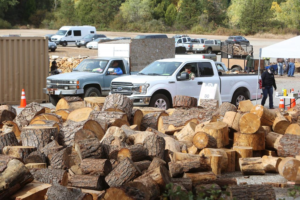 Vehicles packed full of firewood are bound for the homes of area seniors while plenty of firewood remains to be cut for future firewood distributions.