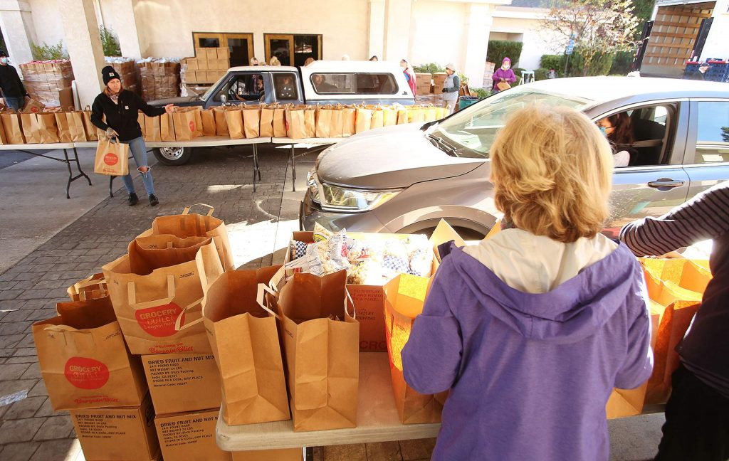 Hundreds of vehicles were served during Thursday's Food Bank of Nevada County food distribution. Over 800 turkeys were distributed to families in time for the holiday with the help of community donations and the KNCO turkey drive.
