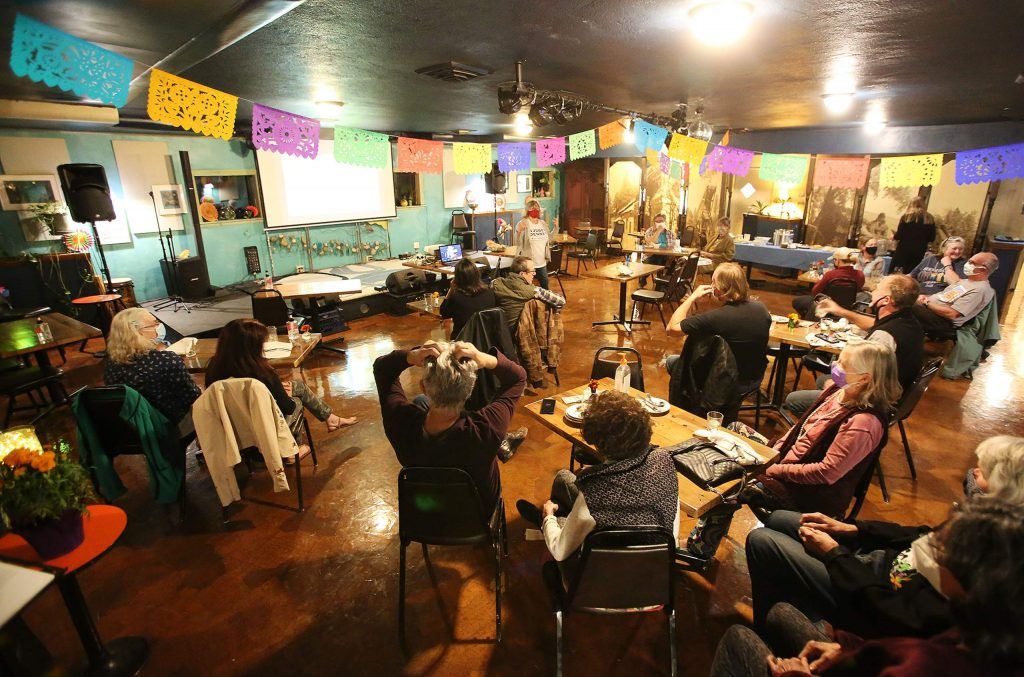 Folks watch patiently for election results as they rolled in Tuesday evening at Wild Eye Pub in Grass Valley.