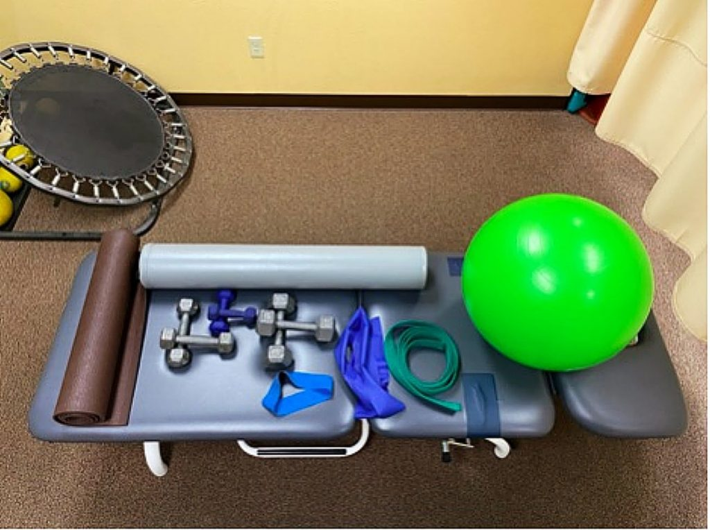 Home gym equipment might include a yoga mat; dumbbell weights in 2, 5, and 10 pounds; foam roller; TheraBand loop; a five foot piece strap for stretching; and a gym ball. This basic set of equipment is less than $200, and you can work every part of the body to stay healthy and fit.