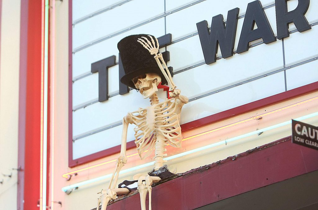 A top hatted skeleton greets folks from the marquis of the Del Oro Theater in downtown Grass Valley Saturday evening.
