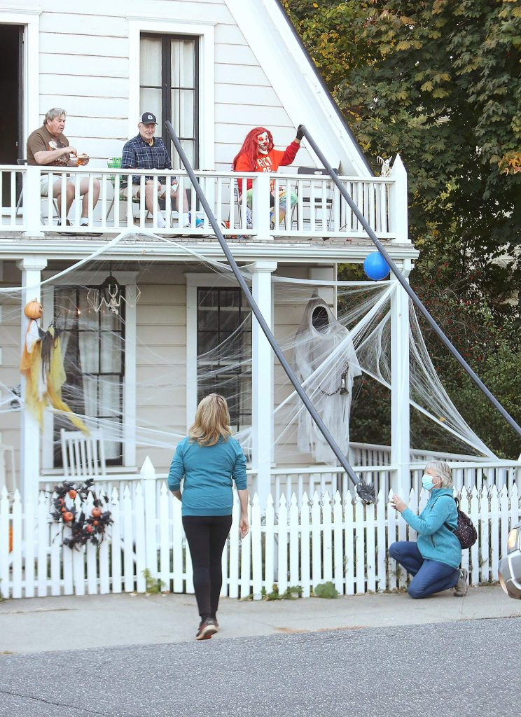 Trick and treat givers along Broad Street came up with this ingenious way to keep socially distant yet still provide candy to passersby on Halloween Saturday evening.