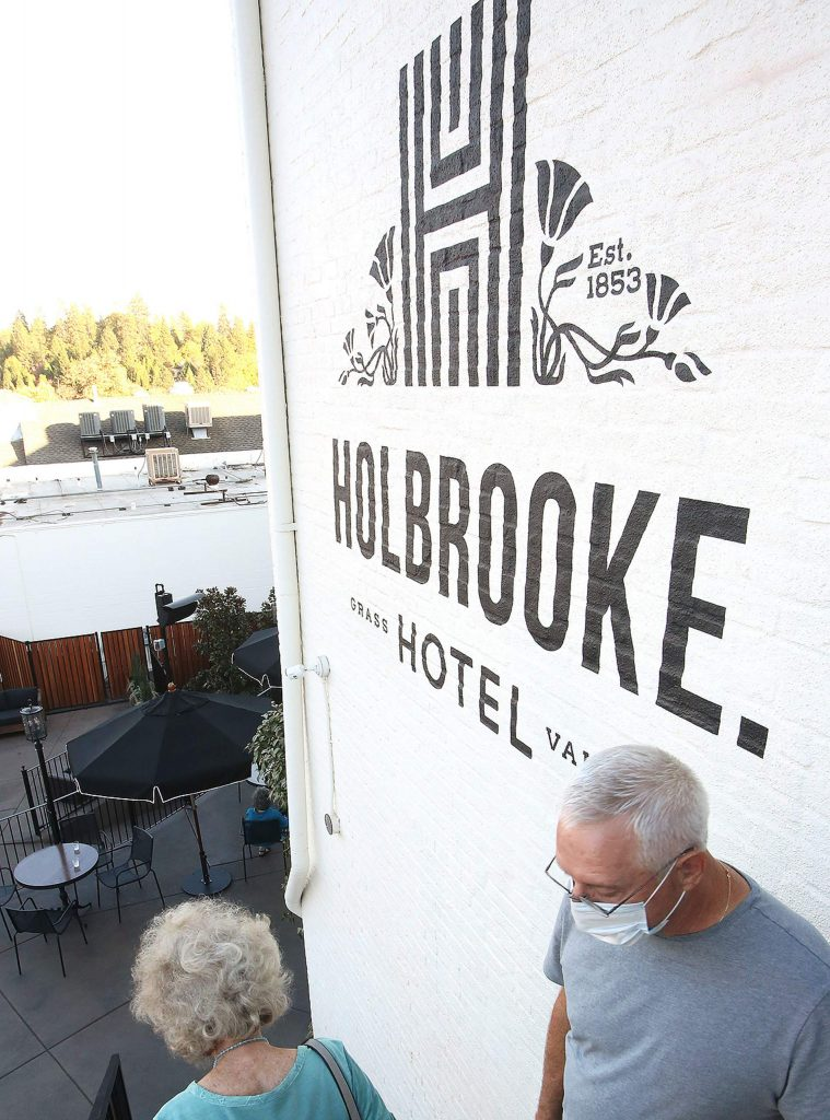 Members of the community take the tour of the new Holbrooke Hotel Thursday in advance of its reopening to the public Saturday.