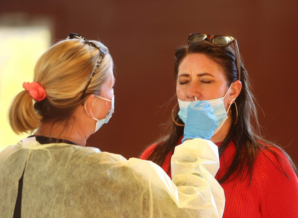 Josie Andrews gets her nostrils swabbed by a nurse administering COVID-19 tests at the Grass Valley Veterans Memorial Building earlier this week. Test results currently come back within a few days.