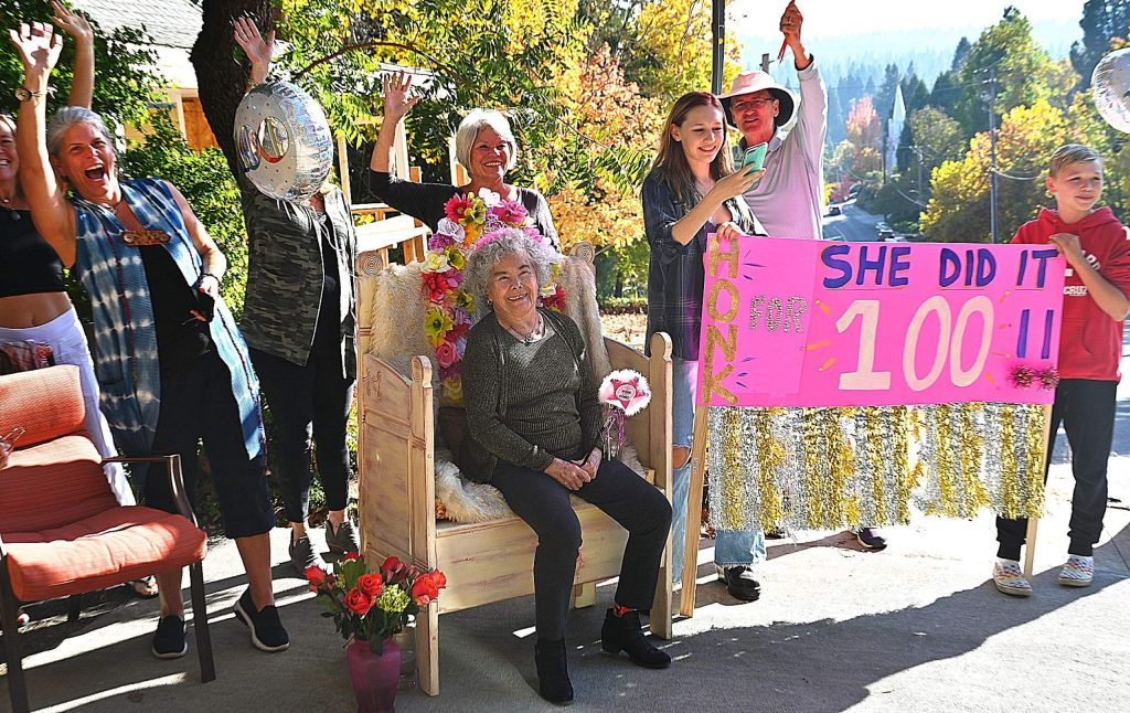 Ruth Renfrow, seated, who officially turned 100 on Thursday, enjoyed a drive-by birthday parade Nov. 1.