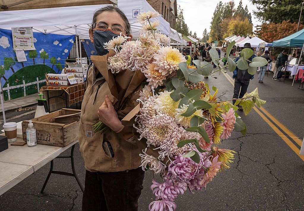 Keren Ram of Nevada City with an armful of flowers from Little Boy Flowers.