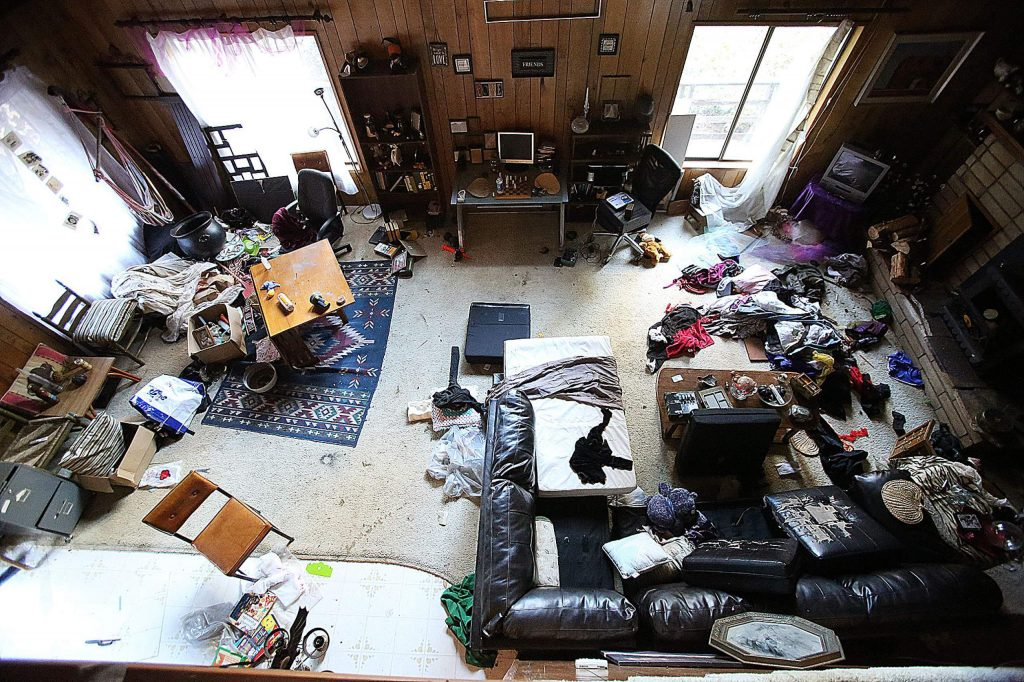 The living room of Lisa Marlowe's Cooper Road home is ransacked and trashed by squatters.