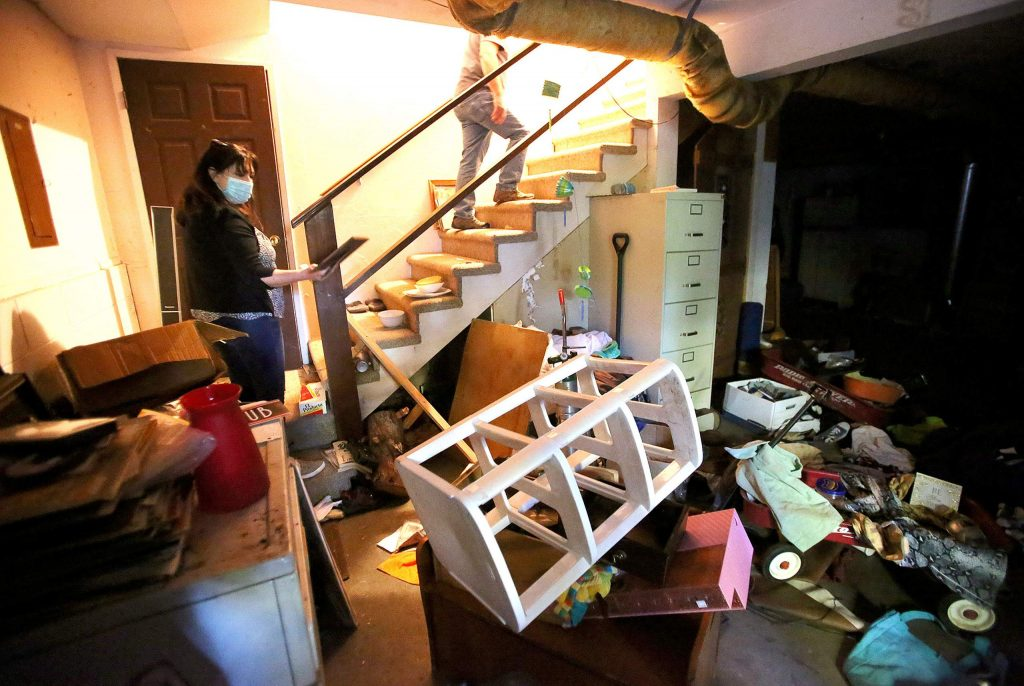 Lisa Marlowe and her husband, Bob, enter their Cooper Road home through the garage, which was also ransacked and left trashed after a group of squatters took up residence.