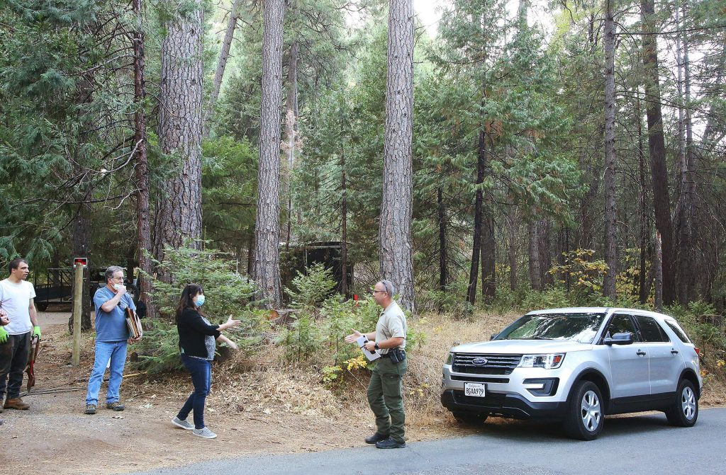 Nevada County Sheriff's Lt. Jason Perry arrives at Marlowe's Cooper Road home while cleanup efforts are underway on the ransacked property.