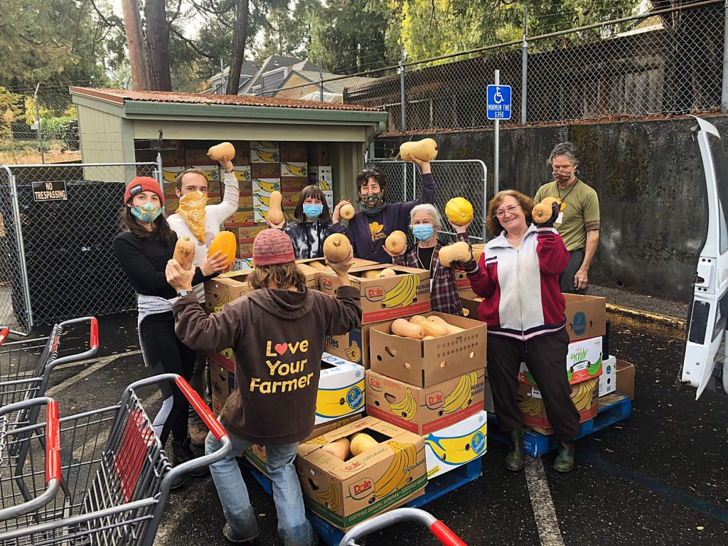 Volunteers celebrate the bounty of a farm gleaning in early November.