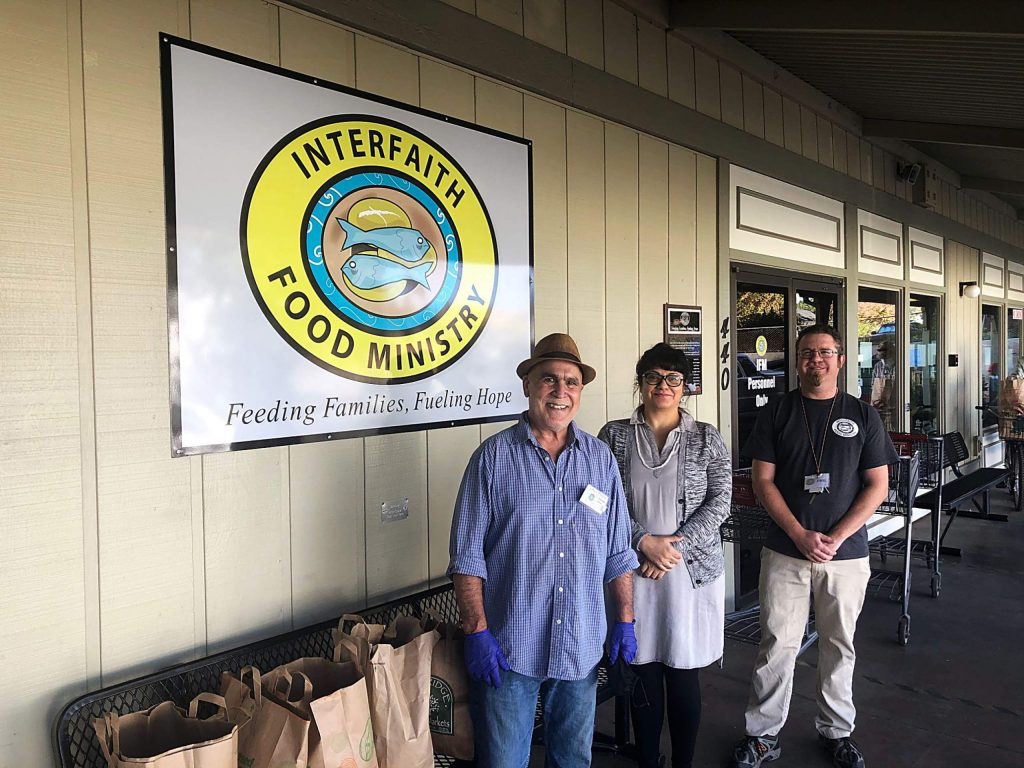 From left, Interfaith Food Ministry employees Steve Messina, distribution monitor; Naomi Cabral, development director; and Phil Alonso, executive director.