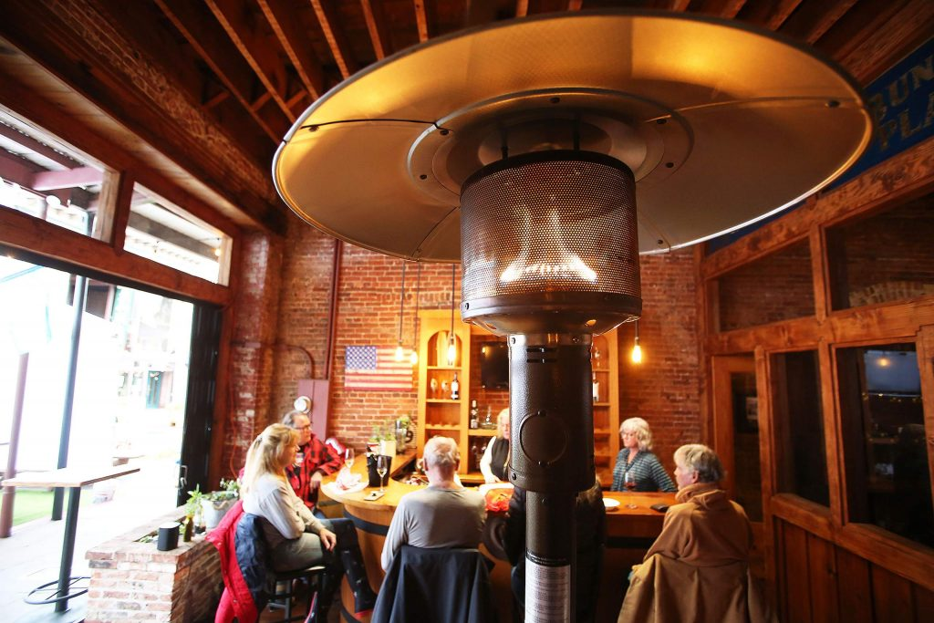 Outdoor space heaters, such as this one set up outside of Cork 49 in downtown Grass Valley, are becoming much more commonplace as establishments do more to follow the recent COVID-19 dining restrictions that call for outdoor dining only.