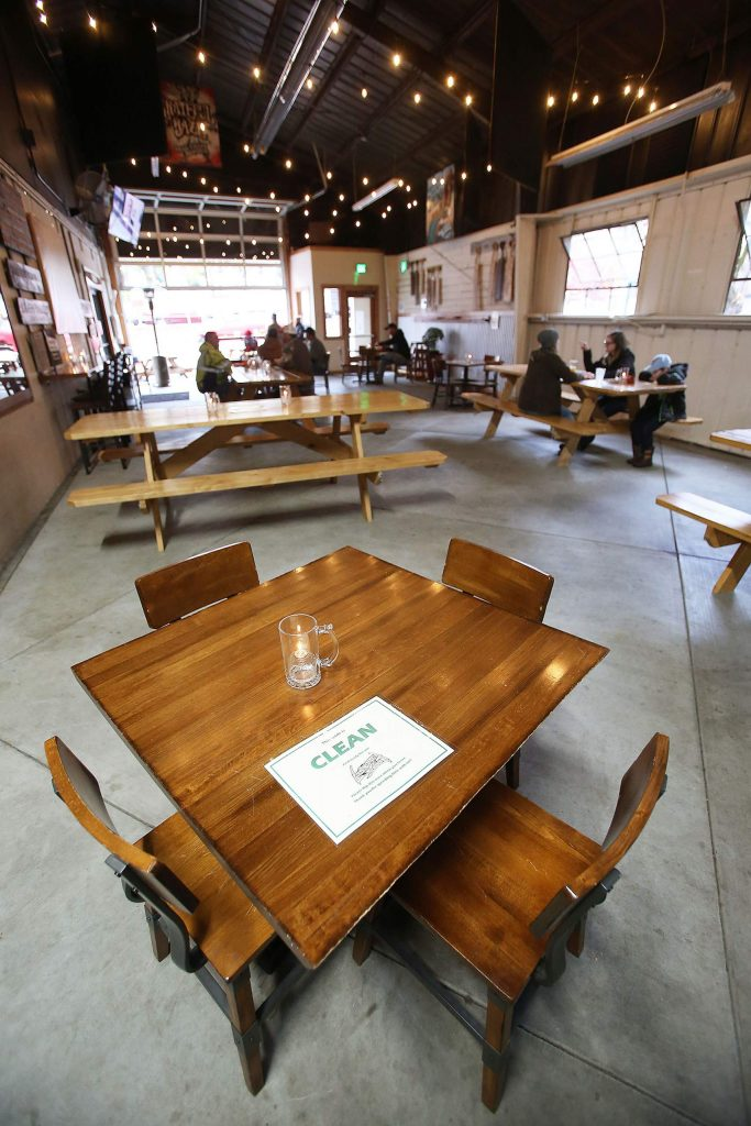 A sanitized dining space at Grass Valley Brewing Co. is ready for customers under its newly remodeled breezeway, which constitutes as outdoor dining.