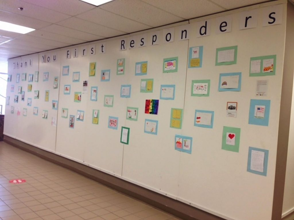 Upstairs at the Rood Center, Thank You Wall for First Responders from young artists.
