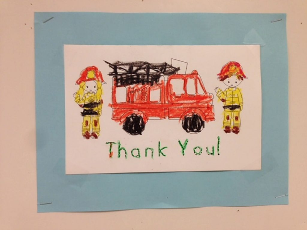 Upstairs at the Rood Center, Thank You Wall for First Responders from young artists